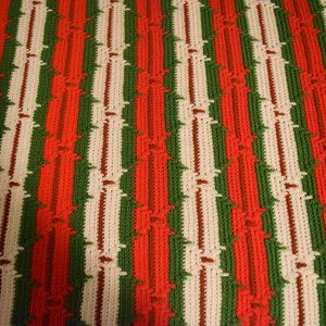 Red and green crocheted afghan throw